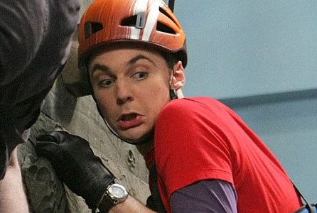 Sheldon, wearing gloves, knows that indoor rock walls can be dirty.  Is he being too hygienic?